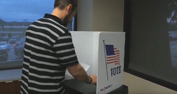 Voter checking the selections on their ballot