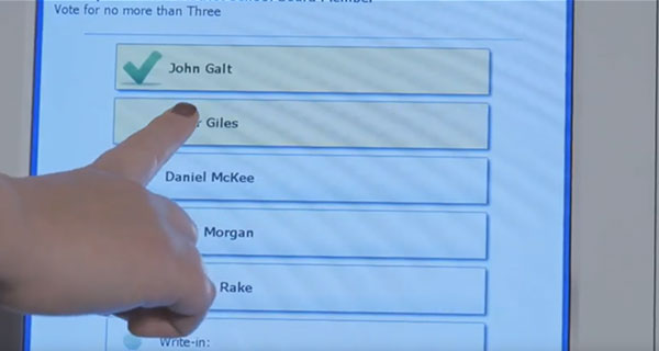 Voter touching screen to select candidate