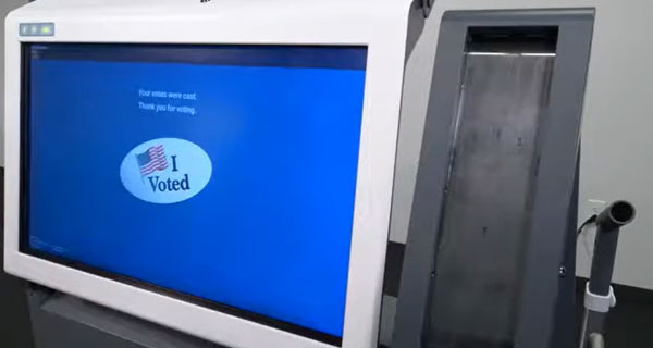Voting machine with screen showing quit or cast buttons.